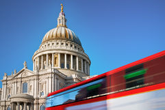 St. Pauls Cathedral, London. St. Pauls cathedral with motion blured double decker bus Royalty Free Stock Photo