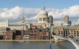 St. Pauls cathedral London and Millennium Bridge over River Thames Stock Photos