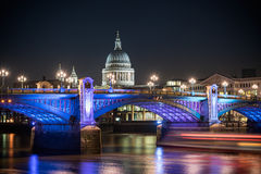 St Pauls Cathedral London. St Paul's Cathedral famous landmark of london poking behind Southwark bridge, London , England Royalty Free Stock Images