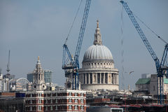St Pauls Cathedral in London Surrounded by Cranes. Construction work in London Town with St Paul's Cathedral in the background near the River Thames Royalty Free Stock Photos