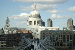 St Pauls Cathedral and the millenium bridge. Showing busy london life Royalty Free Stock Image