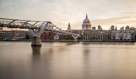St Pauls Cathedral and Millenium Bridge from across the River Th Stock Photos