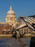 St. Pauls Cathedral and Millennium Bridge, London. St. Pauls Cathedral and the Millennium Bridge from the south bank of the River Thames. London, England, UK Royalty Free Stock Images