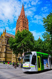 St Paul's Cathedral and modern tram in Melbourne Royalty Free Stock Photo
