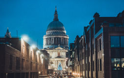 St Pauls Cathedral at night during the Xmas season. View down a London street of St Paul's Cathedral at night during the Christmas season with an illuminated Stock Photo