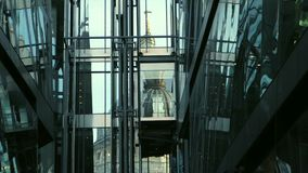 St Pauls Cathedral in reflection. St Paul's Cathedral reflected in glass building in London. Elevator crosses the frame stock video