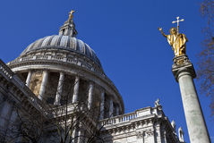 St. Pauls Cathedral and Statue of Saint Paul in London. Looking up at the impressive dome of St. Paul's Cathedral and the Statue of Saint Paul in London Royalty Free Stock Image