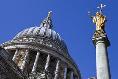 St. Pauls Cathedral and Statue of Saint Paul in London. Looking up at the impressive dome of St. Paul's Cathedral and the Statue of Saint Paul in London Stock Images