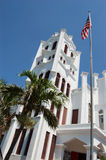 St. Pauls church and flag. Historic St Pauls Church towers over Duval Street in Key West Florida. The congregation flies an american flag on the church property royalty free stock image