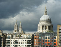 St Pauls London under dark skies. St Pauls in London with storm clouds gathering Royalty Free Stock Image