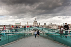 St. Pauls and the Millennium Bridge. A view of St. Paul's Cathedral and the Millennium Bridge in London Stock Photos