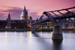 St Pauls Sunset. A spectacular red sunset behind the historic St Pauls Cathedral, on the banks of the River Thames in London Royalty Free Stock Photos