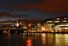 St. Pauls with Thames river at night. Night London's view with St. Paul's cathedral and Thames river. Composition of the cathedral the rail bridge and modern royalty free stock images