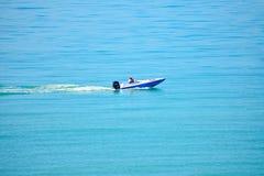 Man enjoying bass boat in Gulf Coast Beaches. St. Pete Beach, Florida. January 25, 2019. Man enjoying bass boat in Gulf Coast Beaches royalty free stock photo