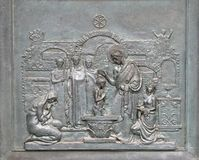 St Peter Baptizing in the Catacombs. Bronze door with the image of the life of St. Peter: St Peter Baptizing in the Catacombs, basilica of Saint Paul Oute the Stock Photos