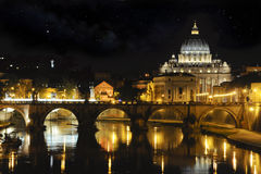 St. Peter basilica and Tiber river at night. View of St Angelo bridge and St. Peter dome at night with reflections on Tiber river royalty free stock photography