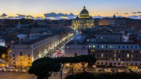 St. Peter basilica vatican illuminated by night lights at dusk hour in Italy stock video footage