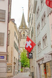 St. Peter church, Zurich with swiss flag Stock Images
