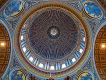 St. Peter dome in Rome. ROME - August 03: Architectural fragment of St. Peter's Cathedral on August 03, 2014 in Vatican (Rome), Italy Stock Image
