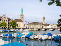St. Peter and Fraumunster over Limmat river Stock Photos