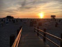 St Peter-Ording de plage de coucher du soleil images libres de droits