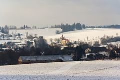 St. Peter and Paul Church in Ceske Petrovice, Czech Republic. St. Peter and Paul Church in Ceske Petrovice, snowy winter country in sunny day, Czech Republic Royalty Free Stock Photos
