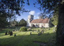 St Peter and Pauls Parish Church Medmenham England. View of the 12th century parish church of Medmenham in Buckinghamshire England taken under tress looking Royalty Free Stock Images