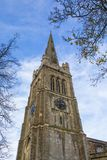 St. Peter and St. Pauls Church in Kettering UK. A view of the spire of the magnificent St. Peter and St. Pauls Church in the town of Kettering in royalty free stock image