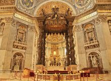 St Peter's basilica alter Vatican Rome Italy. Ornate alter at St. Peter's Basilica recreated by Michaelangelo stands as a shrine in Vatican City Rome Italy Stock Image