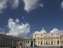 St. Peter's basilica with colonade and fountain. Against cloudscape Stock Photo