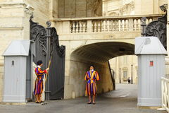 Swiss Guards St Peter square entrance Vatican city. Swiss Guards at the Arch of the Bells Entrance of Vatican city at St Peter square Rome Italy royalty free stock photo