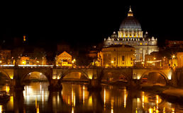 St. Peter's basilica at night. A beautiful view to St. Peter's basilica at night from the bridge Stock Images
