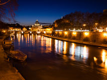 St. Peter's Basilica at Night. St. Peter's Basilica from the River Tiber, a Late Renaissance church located within the Vatican City, Rome Stock Photos