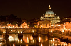 St. Peter's Basilica at night. St. Peter's Basilica and a bridge on Tiber River, Rome Italy Royalty Free Stock Photography