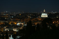 St Peter`s Basilica at Night. Night Exterior St Peter`s Basilica dome above the Rome Italy city skyline Royalty Free Stock Photography