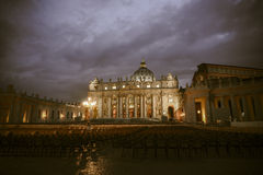 St. peter s basilica at night. St. Peters Basilica at The Vatican in the city of Rome in Italy Stock Photos
