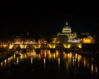 St. Peter`s Basilica at Night. A view of Rome and st. Peters basilica at night from across the river tiber Stock Image