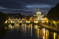 St. Peter`s Basilica and Ponte Sant angelo at dusk in vatican ci Stock Photography