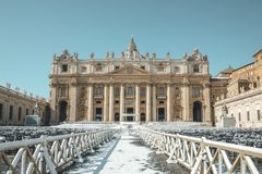 St. Peter`s Basilica Snow. Snow covers St. Peter`s Basilica in the Vatican after a February snowfall Stock Photos