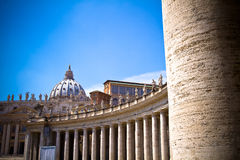 St Peter's Basilica, Vatican. Bernini`s colonnade with the Basilica in background, Vatican City, Rome, Italy Royalty Free Stock Image