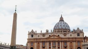 St. Peter`s Basilica in the Vatican City and ancient Egyptian obelisk on the St. Peter`s Square.  stock footage