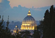 St. Peter's Basilica Vatican City Rome Italy. Lighted view at sunset of the dome of St.Peter's Basilica at the Vatican City in Rome Italy royalty free stock images