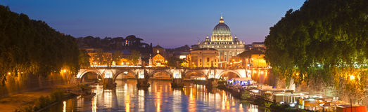 St Peter's Basilica, Vatican City, Rome. St Peter's Basilica (1692) reflected in the river Tiber by pretty night time illuminations, Vatican City Rome Royalty Free Stock Images