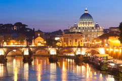 St Peter's Basilica, Vatican City, Rome. St Peter's Basilica (1692) reflected in the river Tiber by pretty night time illuminations, Vatican City Rome Royalty Free Stock Image