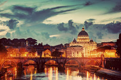 St. Peter's Basilica, Vatican City.  Tiber river in Rome, Italy at late sunset, evening. Stock Photos