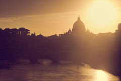 St. Peter's Basilica, Vatican City.  Tiber river in Rome, Italy at sunset Stock Photos