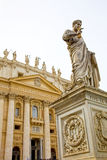 St Peter's Basilica in the Vatican, Rome, Italy. Statue of St Peter in front of St Peter's Basilica in the Vatican, Rome, Italy stock photo