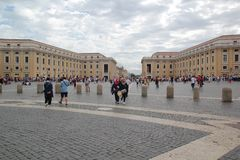 Rome, Italy - September 02, 2017: Visitors are sightseeing St. Peter`s Square on the blue sky and cloud stock photography