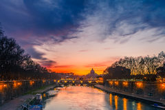 St. Peter's cathedral at night, Rome. Night view of Tiber river in Rome, Italy Royalty Free Stock Images