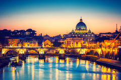 St. Peter's cathedral at night, Rome. Night view of St. Peter's cathedral and Tiber river in Rome, Italy Royalty Free Stock Photo